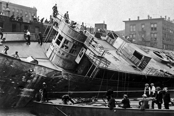 The Eastland ship being righted after the Eastland Disaster on the Chicago River, 1915.