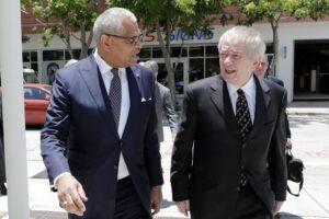 Carnival President Arnold Donald (left)